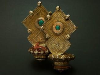 Old earrings or head...