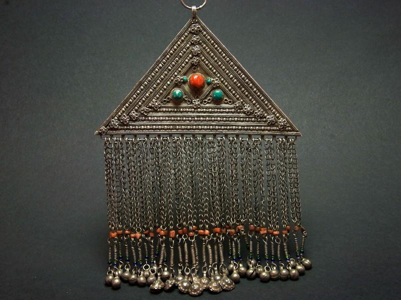 Silver triangle pendant.